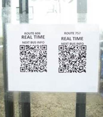 This is an image of a bus tracker QR code posted inside a Pace bus shelter.