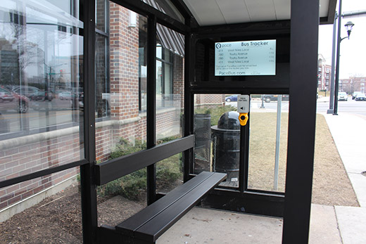 This is an image of an e-ink bus tracker sign imbedded in a Pace bus shelter.