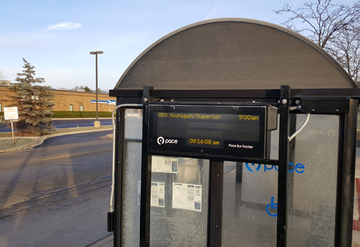 This is an image of a digital bus tracker sign installed on one of Pace's bus shelters.
