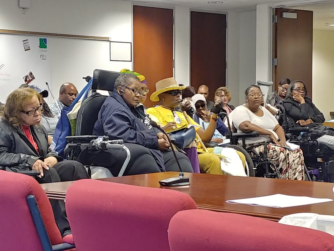 Audience members at an ADA Advisory Committee meeting