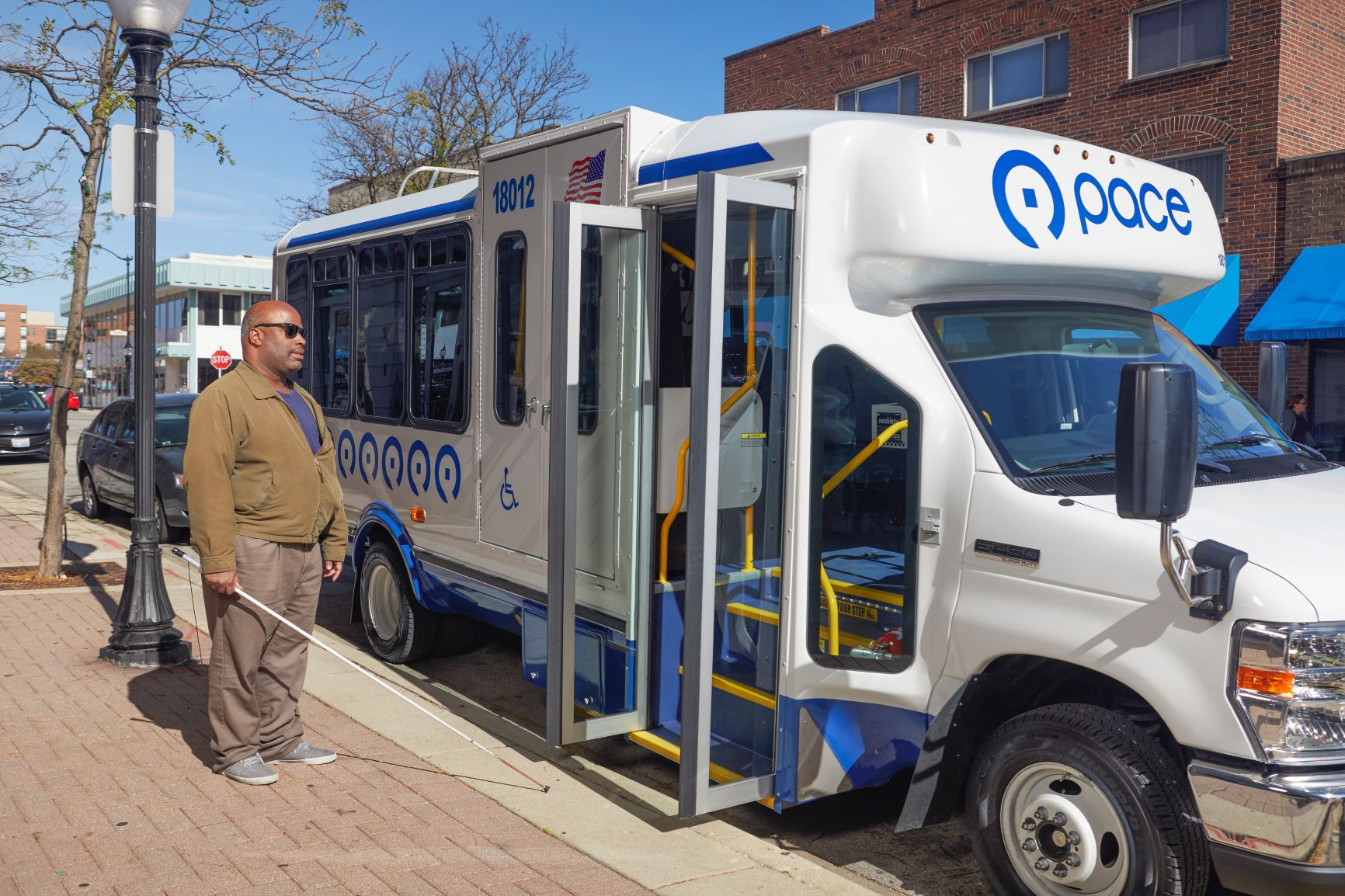 visually impaired rider boards paratransit bus