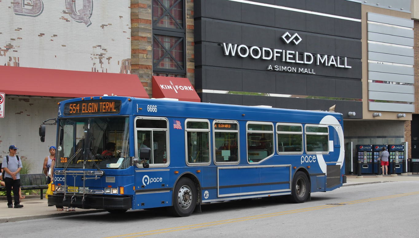 riders boarding a Pace bus at Woodfield Mall
