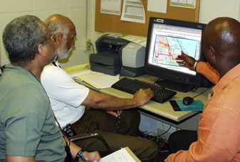 Image of Technicians Looking at IBS Software