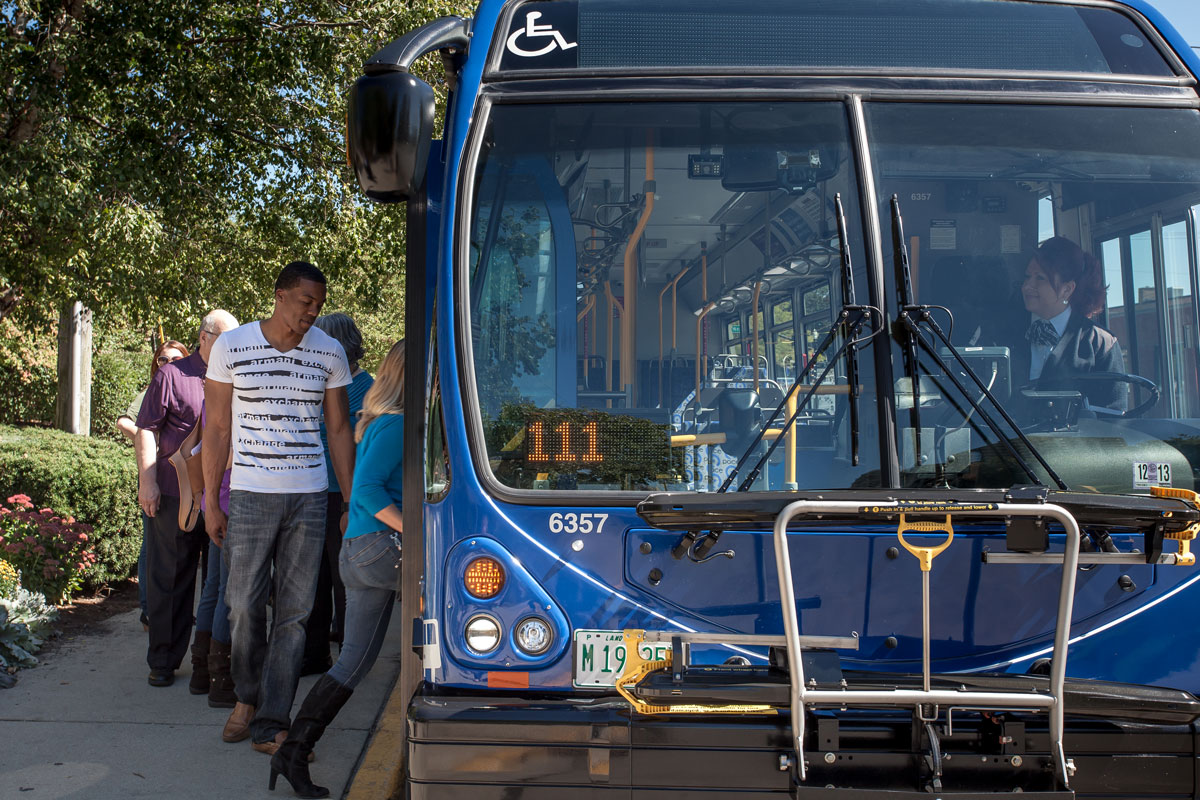 Riders boarding a fixed route bus