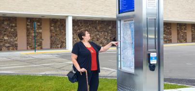 Image of woman viewing map on a Pulse tower